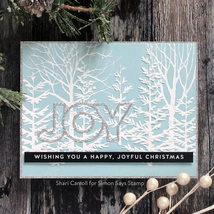 Holly Jolly Blog Hop Shari Carroll Forest Border Embossing Folder, Chunky Joy die, Slimline Christmas Sentiment Strips
