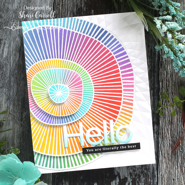 STAMPtember® Blog Party Shari Carroll Concentric Doodle cling, Flipped Hello die, Triangle Burst embossing folder, and Reverse All the Thanks sentiment strips