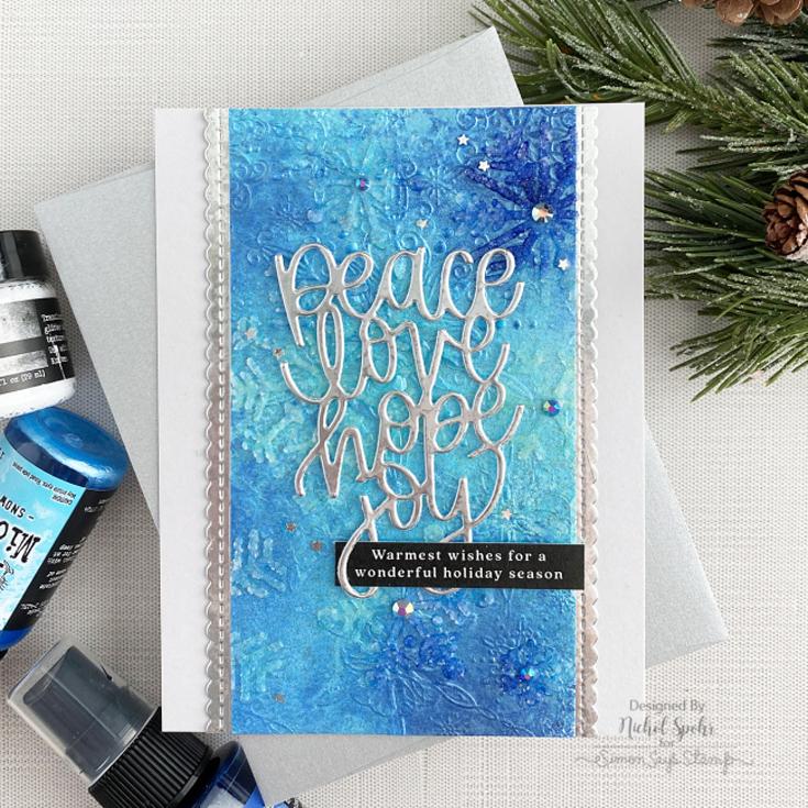 Nichole Spohr World Card Making Day 2021 Filigree Snowflakes embossing folder, Peace Love Hope Joy die, and Reverse Merriest Christmas sentiment strips